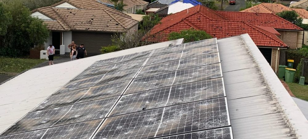 damaged solar panels caused by hail